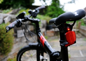 In terms of practical riding this rear reflector and red light dot are what comes with the bike.  You need to buy the rest separately.